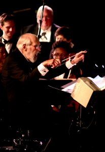 Robert DeCormier conducting at benefit for Operation Respect